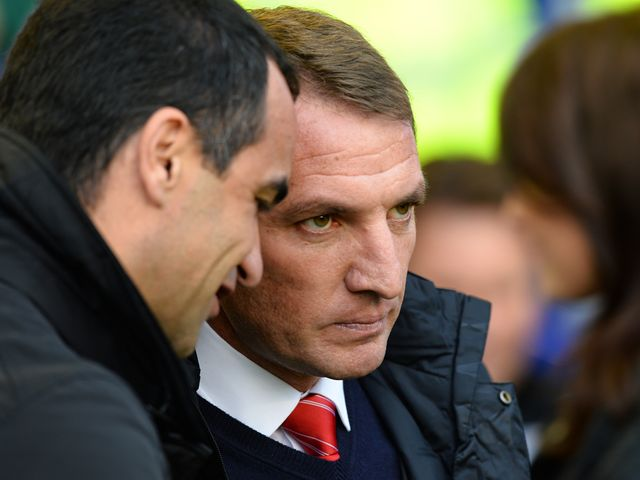 Brendan Rodgers talks with Roberto Martinez