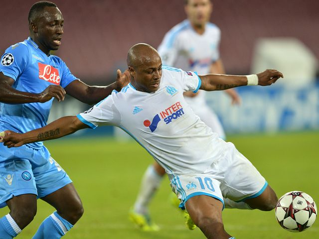 Andre Ayew is put under pressure.