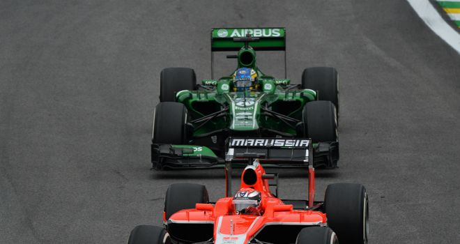 Big boost: Marussia's Jules Bianchi leads Caterham's Charles Pic in Brazil