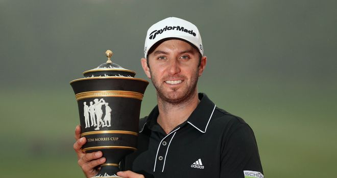 Dustin Johnson holds the trophy after his three-shot triumph
