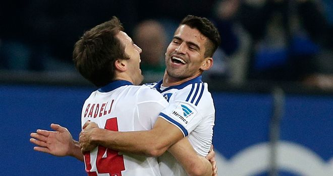 Milan Badelj (left) of Hamburg celebrates
