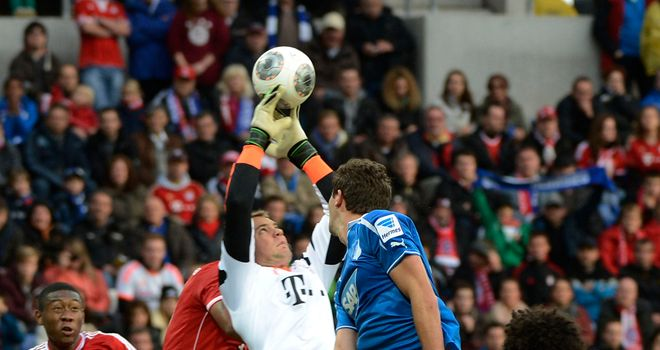 Bayern Munich keeper Manuel Neuer catches under pressure