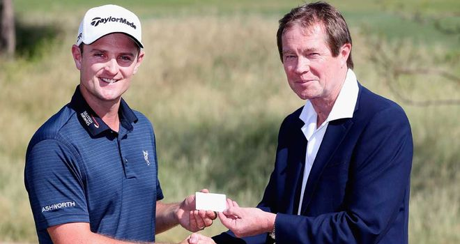 Justin Rose receives his silver membership card from chief executive George O'Grady