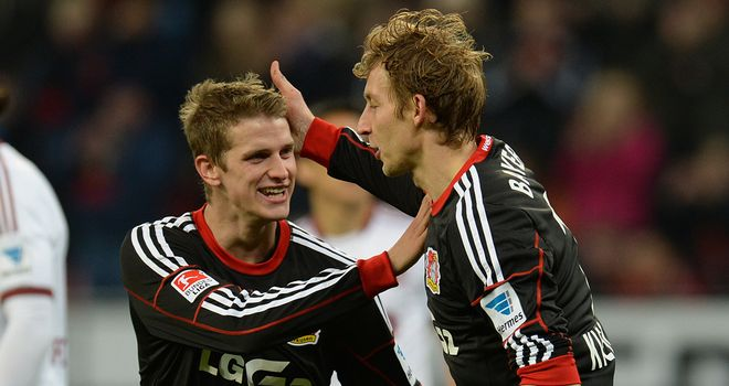 Stefan Kiessling and Lars Bender celebrate for the hosts