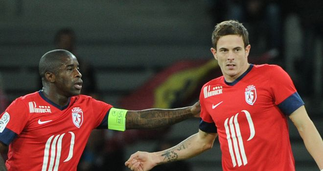 Rio Mavuba and Nolan Roux celebrate for Lille