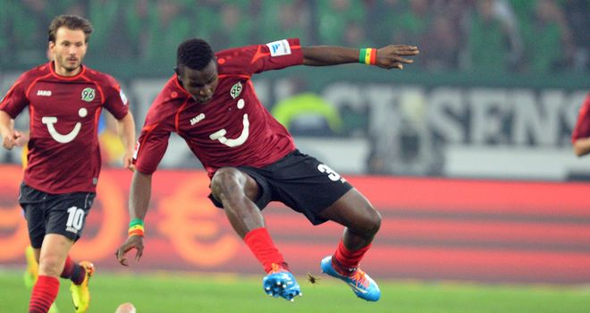 Hannover's Mama Diouf evades a challenge