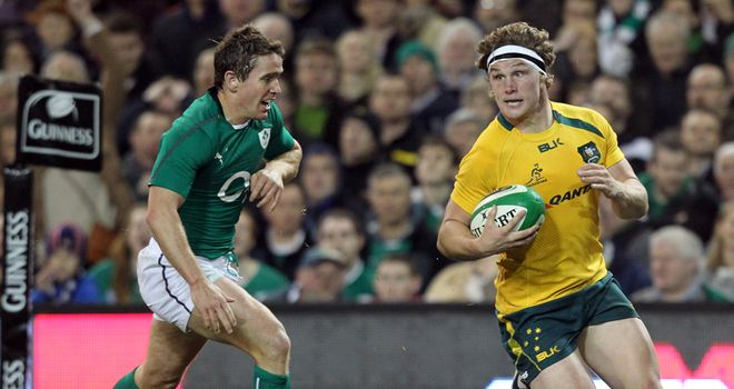 Michael Hooper evades Ireland scrum-half Eoin Reddan to score Australia's second try