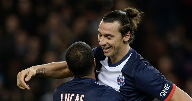 Zlatan Ibrahimovic celebrates with Lucas Moura