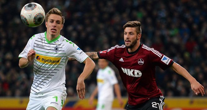 Patrick Herrmann of Moenchengladbach and Marvin Plattenhardt of Nuernberg