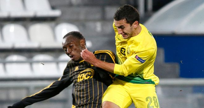 Serder Serderov (right): Anzhi forward tussles with Djibril Paye