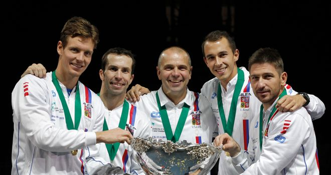 Tomas Berdych, Radek Stepanek team captain Vladimir Safarik, Lukas Rosol and Jan Hayek hold the trophy aloft