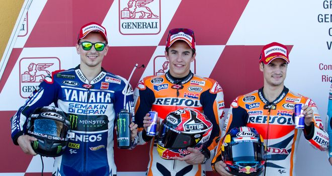 Marc Marquez (centre), Jorge Lorenzo (left) and Dani Pedrosa (right) after qualifying