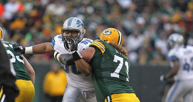 Ndamukong Suh of the Detroit Lions rushes against Josh Sitton of the Green Bay Packers at Lambeau Field