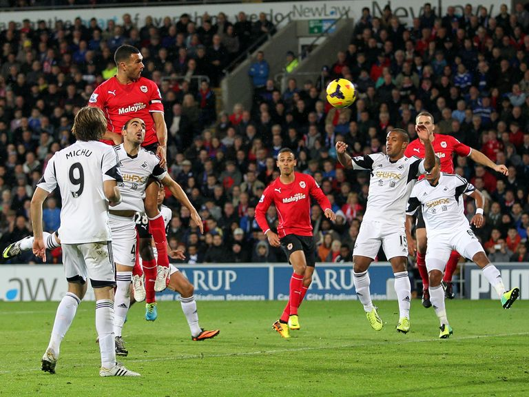 Steven Caulker heads home Cardiff's winner against Swansea.