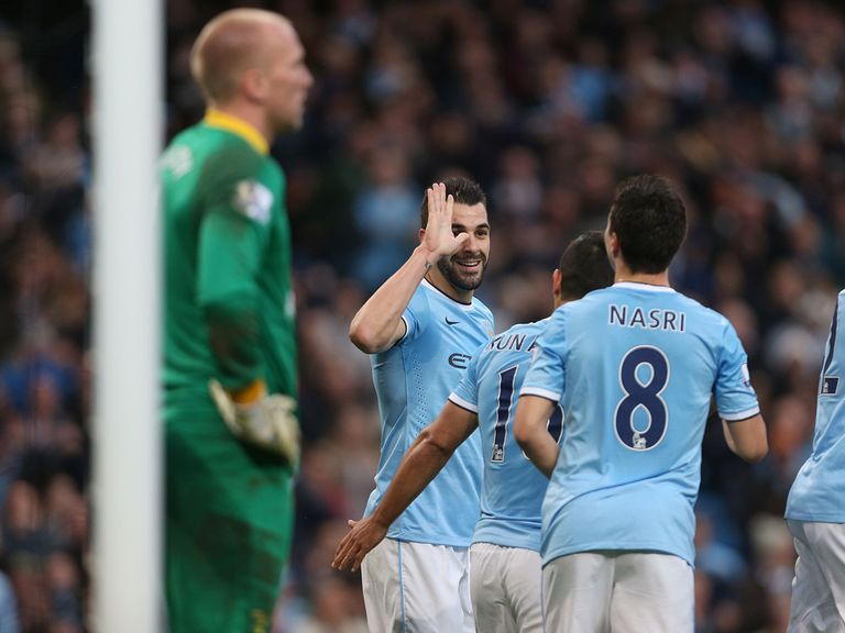 Manchester City enjoy the 7-0 victory over Norwich.