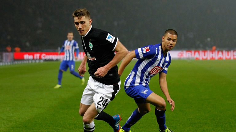 Nils Petersen and Marcel Ndjeng watch the ball