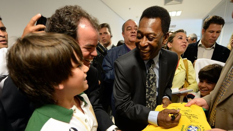 Pele at the inauguration of the 'Brazil, one country, one world' exhibition in Brasilia