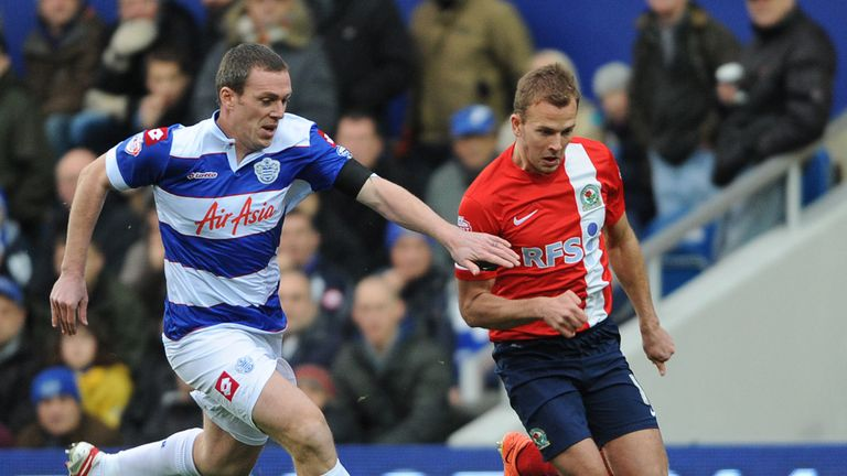 Richard Dunne challenges Jordan Rhodes for the ball