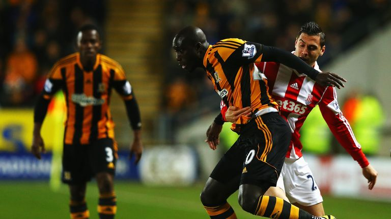 Yannick Sagbo: The Hull striker tangles with Geoff Cameron in the 0-0 draw
