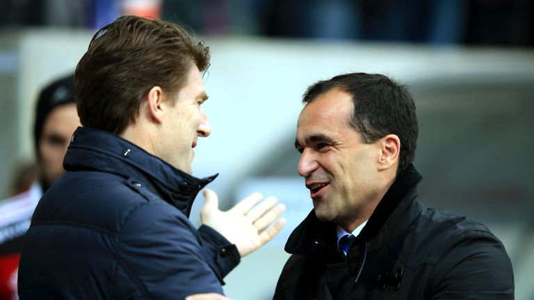 Roberto Martinez (r): Greeted by Michael Laudrup