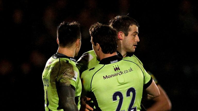 Stephen Myler is congratulated by team-mates after kicking the match-winning penalty