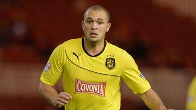 Joel Lynch: Signs extension at Huddersfield