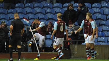 Burnley's Michael Kightly kicks over the corner flag in celebration of scoring his team's winning goal during the Sky Bet Championship match at Turf Moor,