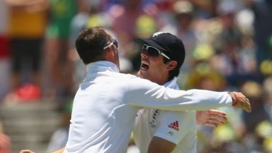Graeme Swann and Alastair Cook celebrate the wicket of Michael Clarke in Perth