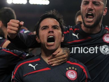 Olympiacos beat Anderlecht 3-1 to progress in the Champions League.