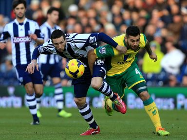 Morgan Amalfitano and Bradley Johnson battle for the ball
