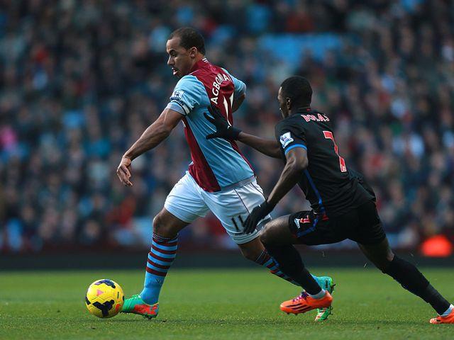 Gabriel Agbonlahor holds off Yannick Bolasie