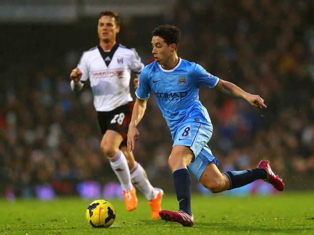 Samir Nasri brings the ball forward for Man City at Craven Cottage