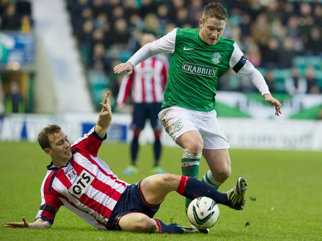 Jeroen Tesselaar makes a tackle on Paul Cairney