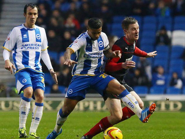 Liam Bridcutt shows his strength against Paul Dixon