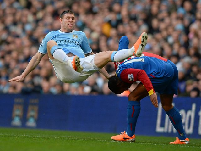James Milner falls to the ground