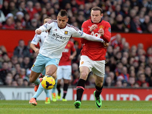 Ravel Morrison and Wayne Rooney battle for the ball