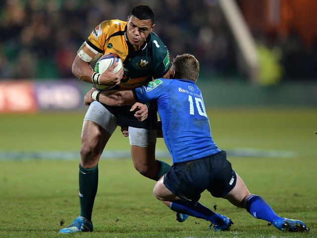 Luther Burrell is tackled by Ian Madigan.