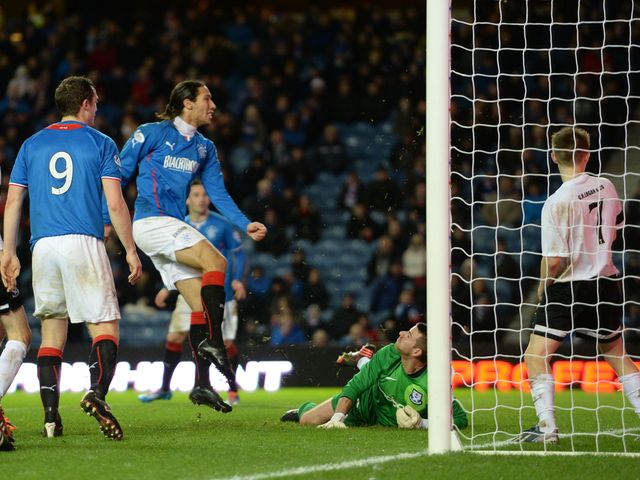 Bilel Mohsni scores to give Rangers a 3-0 lead