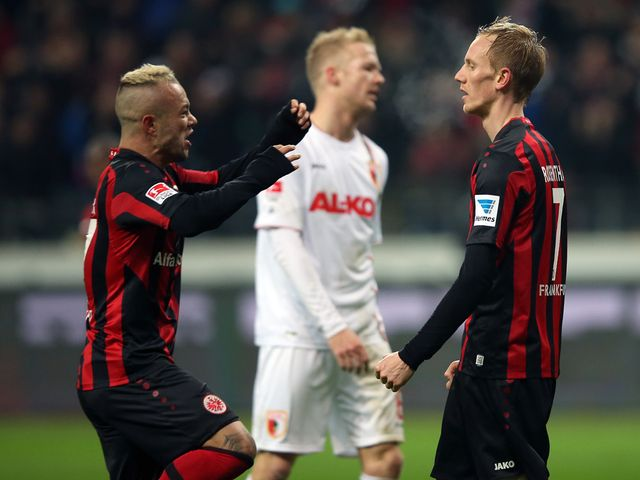Jan Rosenthal (r) is congratulated on his equaliser by Stephan Schroeck