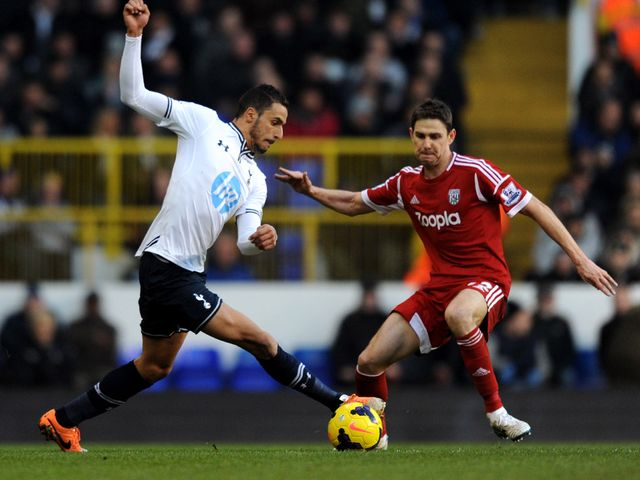 Nacer Chadli tries to skip past Zoltan Gera