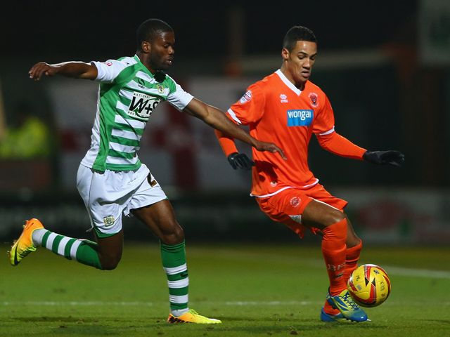 Joel Grant of Yeovil challenges Tom Ince