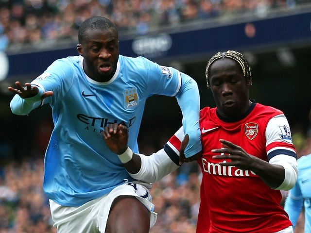 Yaya Toure and Bacary Sagna in action
