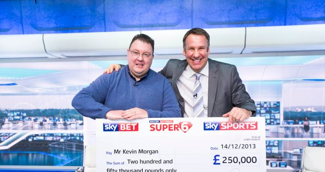 Jackpot winner Kevin Morgan is presented with his cheque for £250,000 by Soccer Saturday pundit Paul Merson.