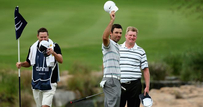 Charl Schwartzel acknowledges the galleries after sealing victory at Leopard Creek