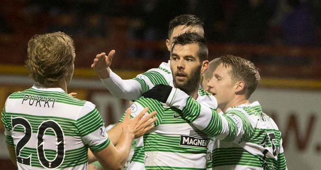 Kris Commons (right): Celebrates his first goal in the 5-0 win at Motherwell