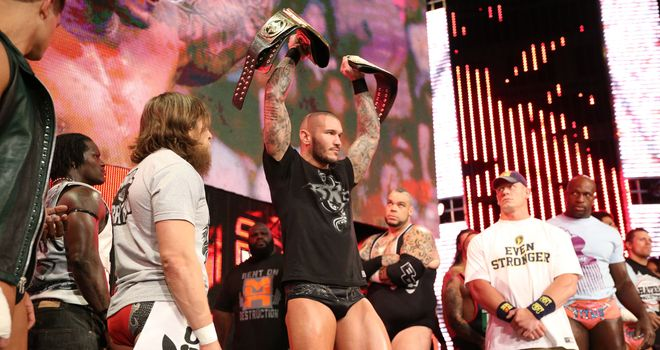 Orton holds his belts aloft, as his rivals Bryan (L) and Cena look on