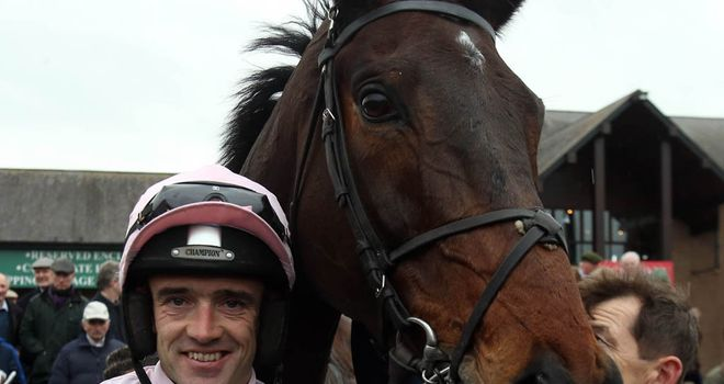Ruby Walsh poses with the winner after the race