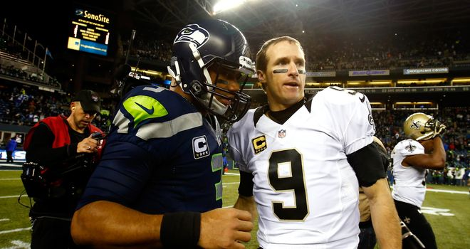 Quarterbacks Russell Wilson of the Seattle Seahawks and Drew Brees of the New Orleans Saints