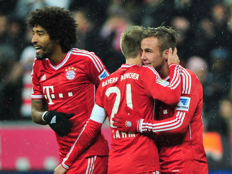 Dante, Philipp Lahm and Mario Gotze celebrate