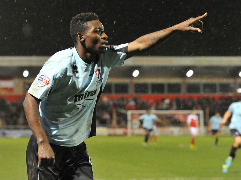 Jermaine McGlashan celebrates his goal for Cheltenham